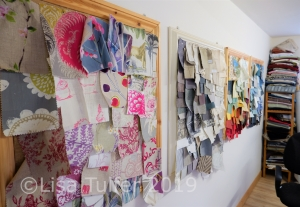 Photo of four pin boards with fabric samples on the wall of Hannah's workshop
