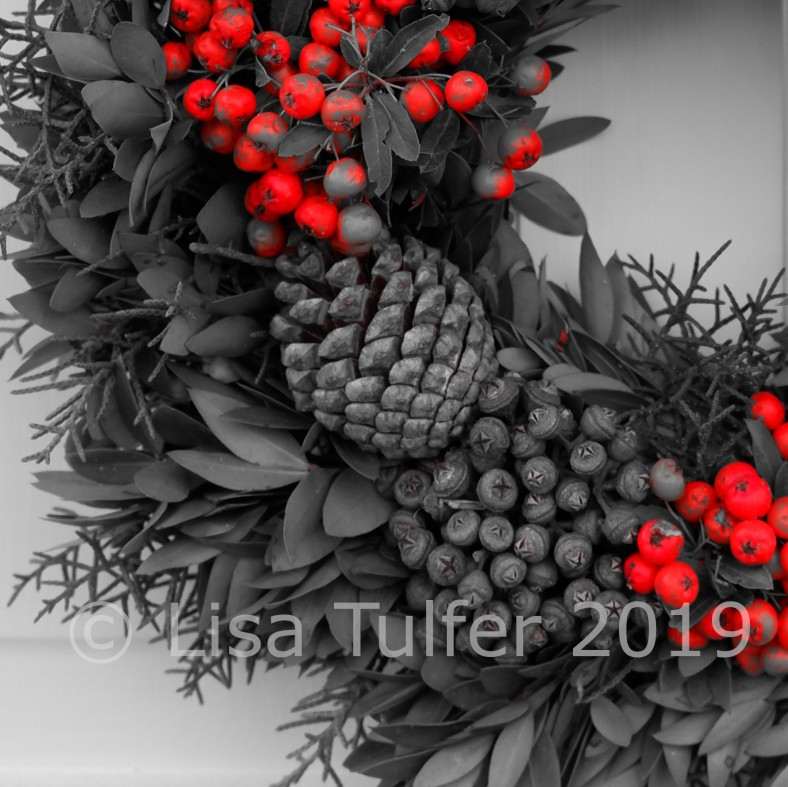 Photo of a quarter of a wreath, in mono with a pop of red for the berries.  Image copyright Lisa Tulfer 2019