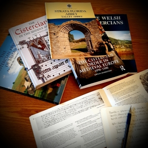 Colour photograph of books about Cistercians, and a notebook.