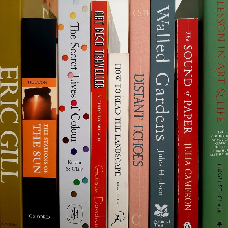 Colour picture of a shelf of books.