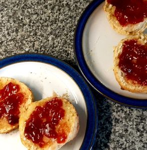 Photograph of scones with butter and jam