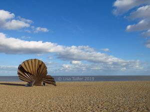 Colour photograph of The Scallop sculpture by Maggi Hambling on Aldeburgh beach