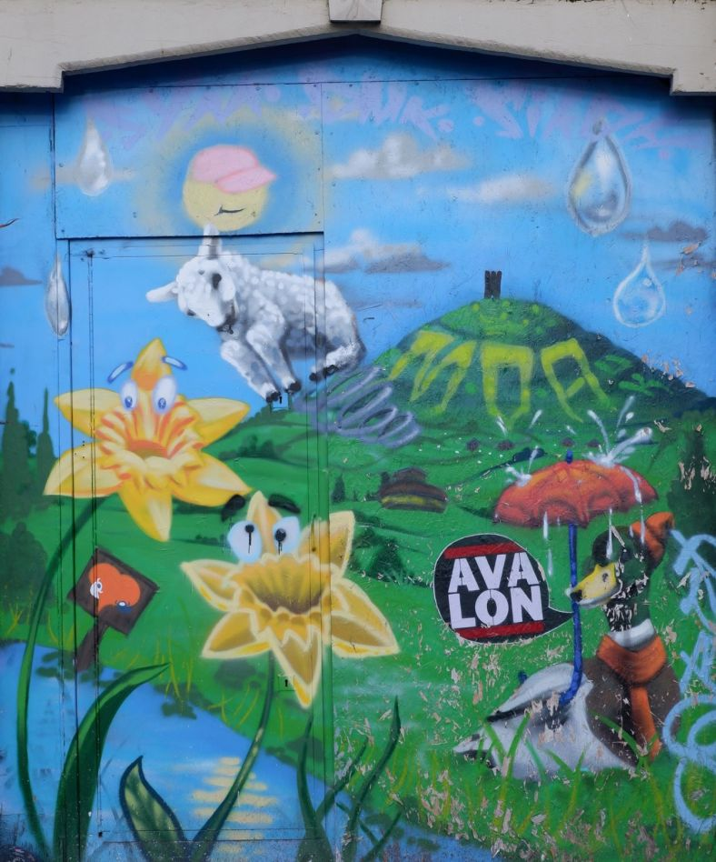 Photograph of colourful mural of Glastonbury Tor.