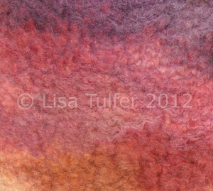 Textile art by Lisa Tulfer - an abstract composition in shades of plum, pink and ochre.  Wet process felt, 100% sheep's wool. Image copyright Lisa Tulfer 2012.